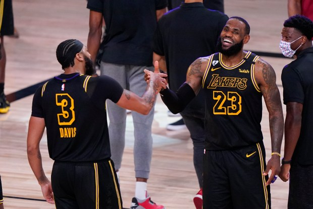 In the bubble, LeBron James' routines and team bonds have kept him and Lakers on track