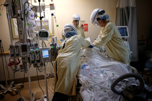 Pandemic-weary medical teams watch warily as LA County widens business access
