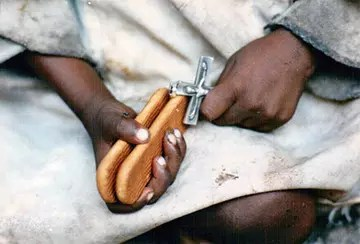 Child holding bread in Sudan