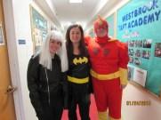 Three people in superhero costumes