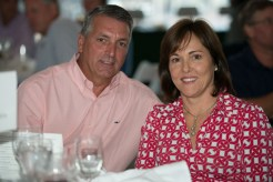 Man and Woman at a table during the 2013 Howard F. Treiber Memorial Golf Outing