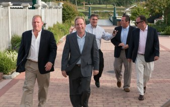 Five men walk towards the camera while in conversation at the 2013 Howard F. Treiber Memorial Golf Outing