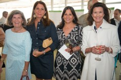 Four women smile together at the 2013 Howard F. Treiber Memorial Golf Outing