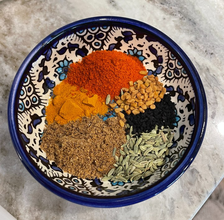 the spices that give this handi its achari flavor
