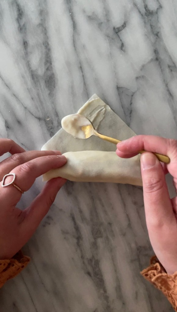 seal the egg rolls with some flour and water paste