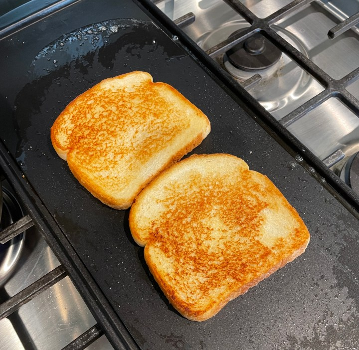 Fry the bread in butter until crispy and golden brown