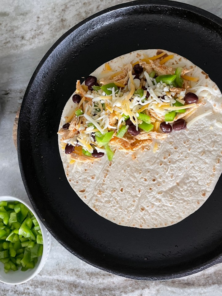for the best loaded quesadillas use a cast iron skillet and butter