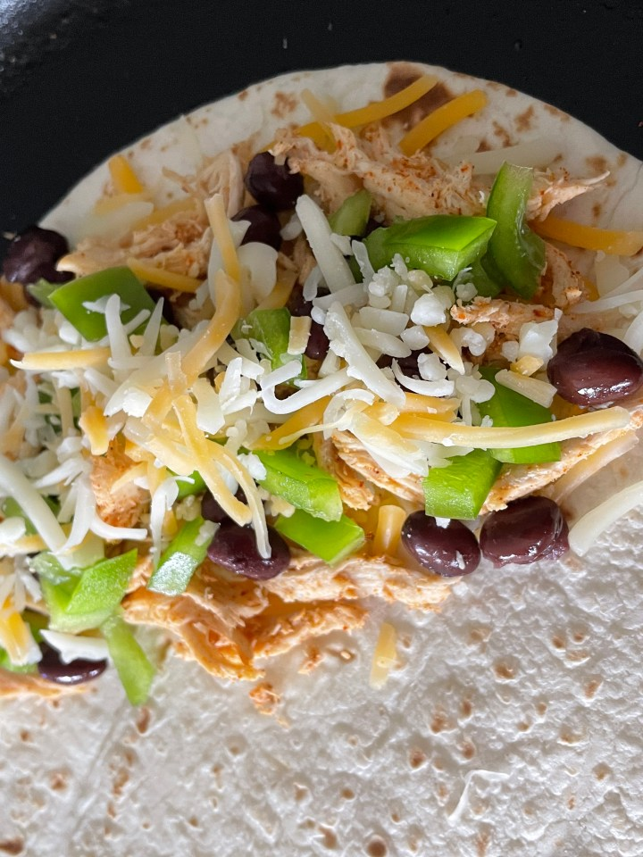 add cheese on top as well so the tortillas sticks together