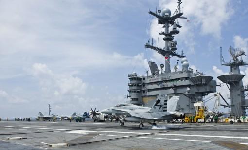 An F/A-18D Hornet makes an autonomous landing on the carrier Harry S. Truman.