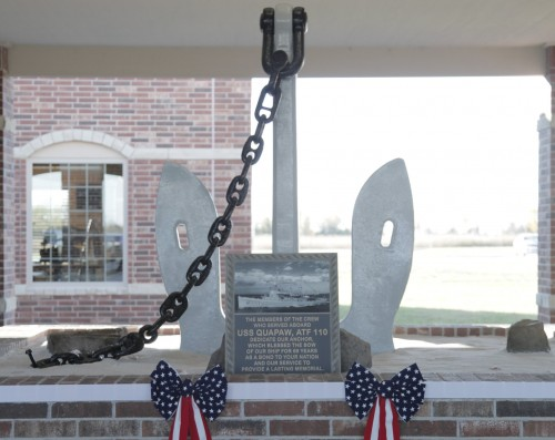 An anchor was presented to the Quapaw tribe earlier this month in a ceremony attended by 18 sailors who served on the ship of the same name. The fleet ocean tug earned battle stars during World War II, Korea and Vietnam. (Photo by Luke Anderson)