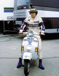 Nelson Piquet in 1984 having won another Vespa PX!