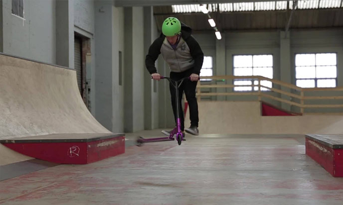 Heel whip scooter trick