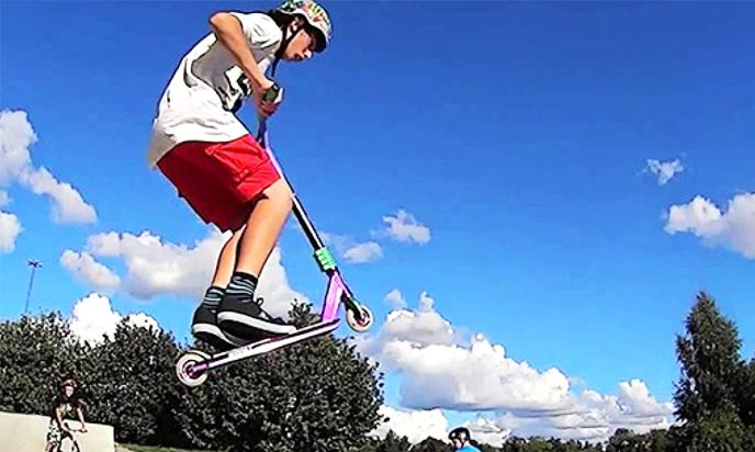 Tail Grab Scooter Trick