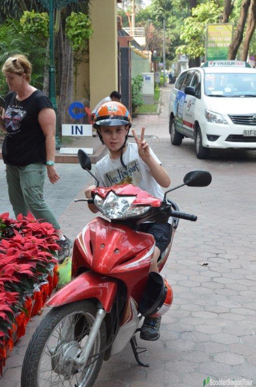 kid on motorbike tour in saigon 2
