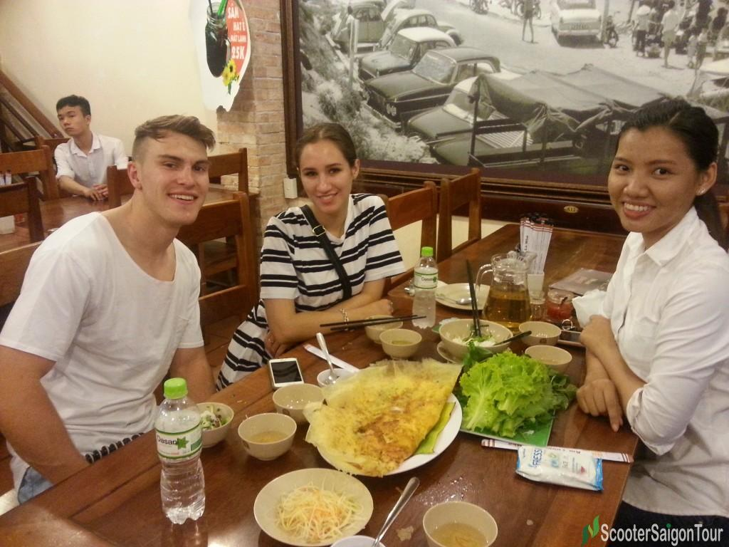 saigon food tour eating Banh Xeo