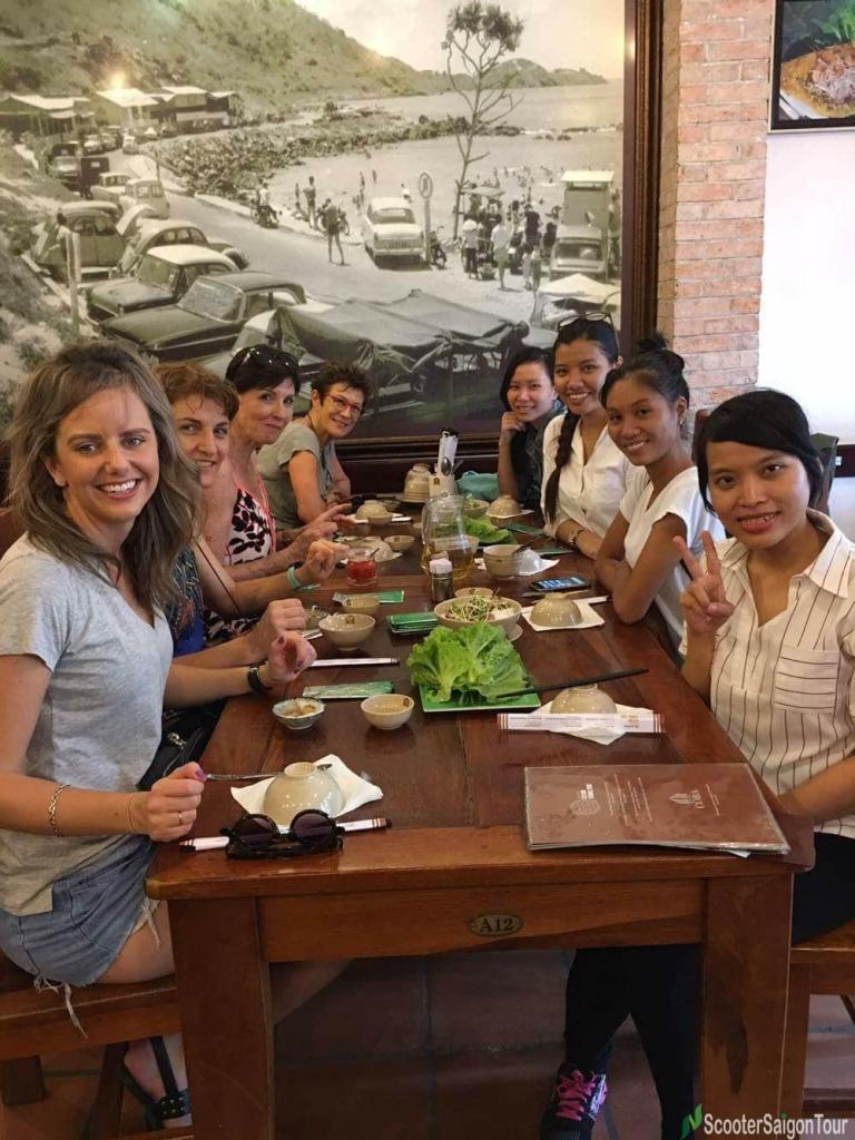 eating-banh-khot-on-saigon-sightseeing-tour-and-street-foods-by-motorbike-tracy-do