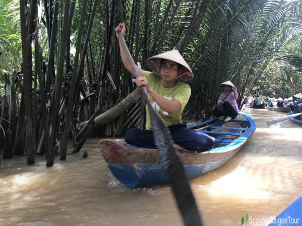 Man Wearing Conical Hat In Mekong Delta