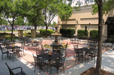 Stonecrest Shopping Center looked to SCOPE to provide plaza designs that would enhance two unique outdoor spaces. This image showcases the additional seating, landscaping and creative brick and concrete patterned flooring.