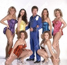British comedian/entertainer JIM DAVIDSON as Buttons with his girls in the pantomime Sinderella. 1992.