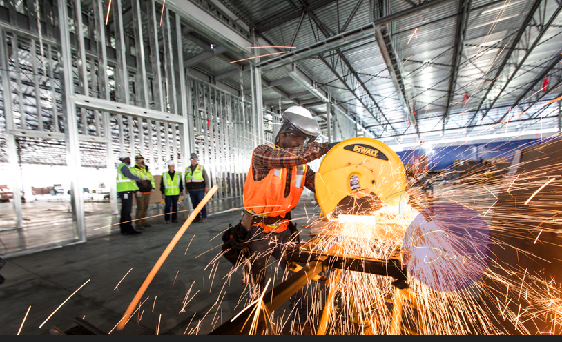 A sheet metal fabricator saw-cuts material for Apple's data center expansion in Reno, Nevada.