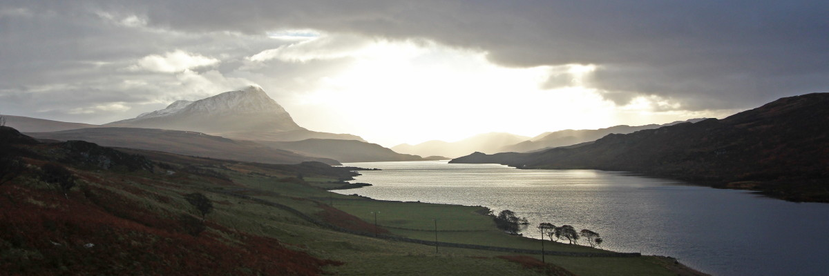 Photo of Ben Hope, the most northerly Munro, resplendant above Loch Hope on a blustery autumn afternoon
