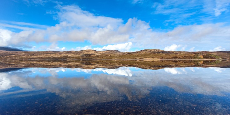 Photo of near perfect reflections on a beautiful, still May morning on Loch Hope