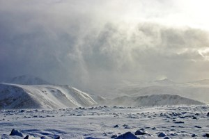 Photo looking south east from the summit of Arkle at the back end of a squally snow shower departing to the south east