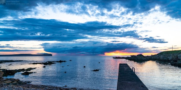 Photo of a storm passing over the Pentland Firth late on a June evening; from the scenic Scarfskerry Harbour