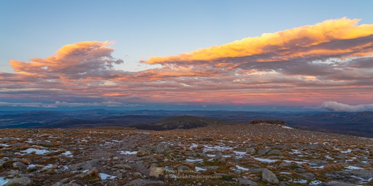 Photo of an easterly view from the summit of Cairngorm with clouds highlighted by the setting sun