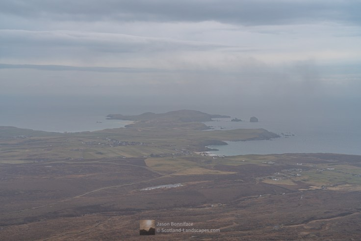 A view through mist to Durness and the headland of An Fharaid (Faraid Head) from the summit of Beinn Ceannabeinne