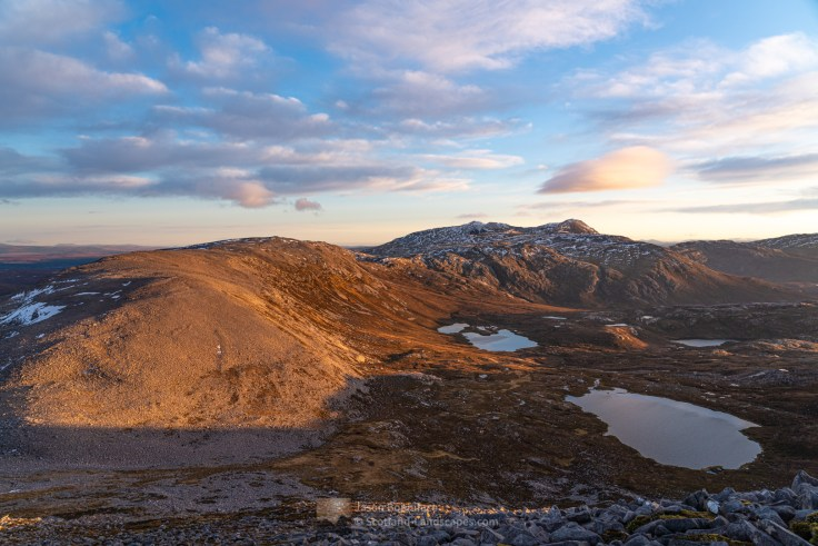 Beinn Uidhe glowing in the low afternoon sunlight with Ben More Assynt and Conival beyond