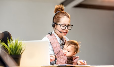Businesswoman working with her baby son at the office