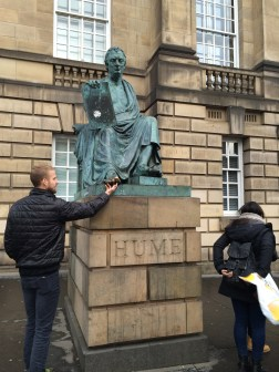 Everyone else rubbed the golden toe, Bobby tickled it. A statue of David Hume, a philosopher during the enlightenment, with his foot on the 10 Commandments, is directly across the Street from St. Giles.