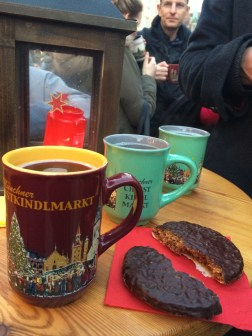 Glühwein (hot wine aka Mulled Wine). Disposable cups are not allowed here. Everything is sold in these cute mugs. There's a €3 deposit, or you can keep the mug. That ginger cookie was amazing.