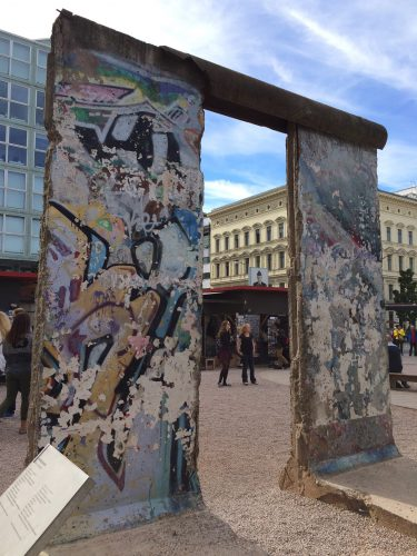 A part of the Berlin Wall in an outdoor exhibit at Checkpoint Charlie