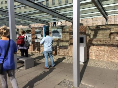 What remains of the SS Headquarters is the brick background behind this beautiful outdoor exhibit, a timeline of WW1, WW2, and through the end of the Cold War.