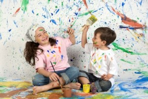 Children playing with painting with the background painted