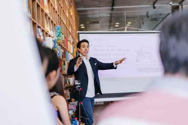 Entrepreneurial Academy. man in suit jacket standing beside projector screen