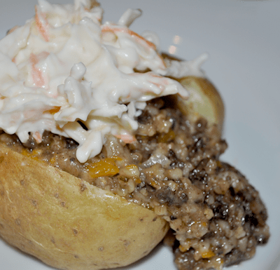 Slow Cooked Haggis in a Baked Potato & served with Coleslaw