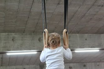 small child on rings