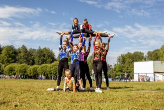 cheerleading group with young one