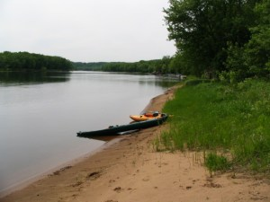 two kayaks on the riverbank