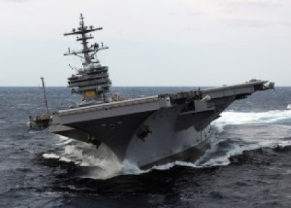 Aircraft carrier turning hard and leaning far over
