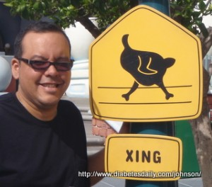 """Picture of George by a """"Chicken Crossing"""" sign at DisneyLand"""