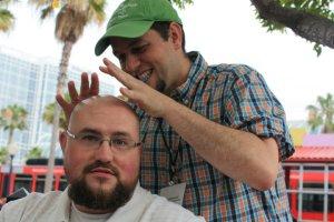 Manny pretending Scott's bald head is a crystal ball