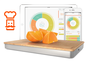 Image of the Prep Pad with Oranges on it and an iPad & iPhone behind it