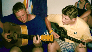 Scott and Nathan writing songs on guitar