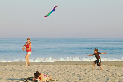 A mother flys a kite with her son on the Ocean City (New Jersey) Beach