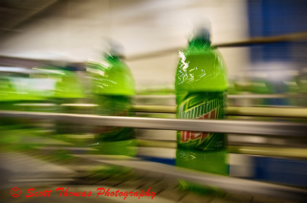 Mountain Dew bottle moves down a conveyor to be shipped out to stores.