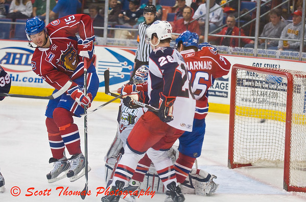 Hamilton Bulldogs forward Adam Pineault (15), on his toes, deflects the puck into the Syracuse Crunch goal.